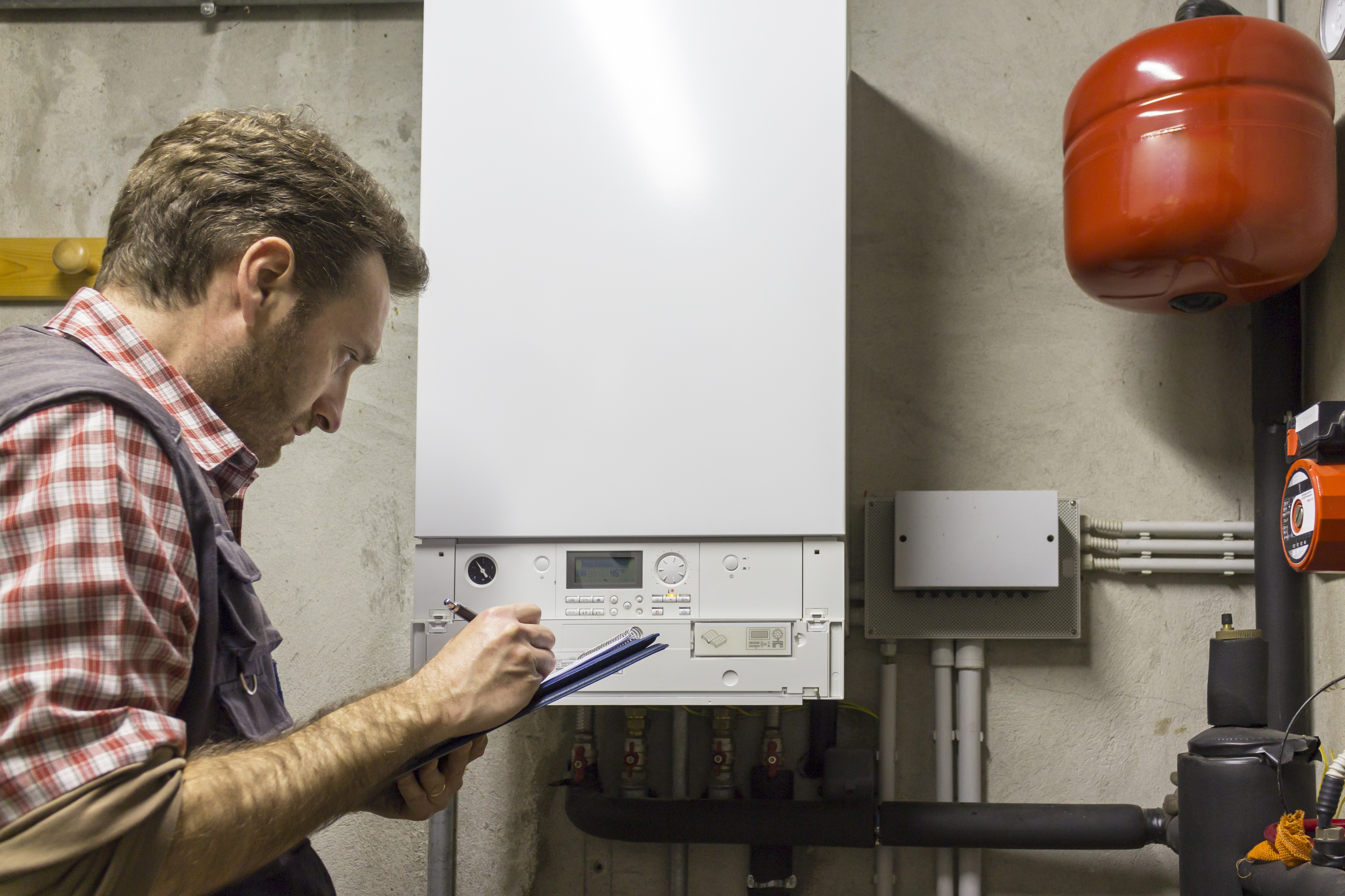 Qualified boiler engineer checking boiler