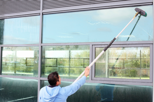 Window cleaner using the water fed pole system also called reach and wash.