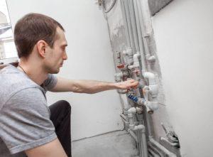 Engineer checking boiler pipework – relocating boiler