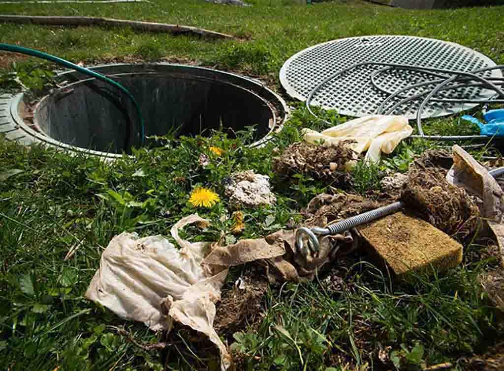 Drain unblocking tools surrounding an open drain