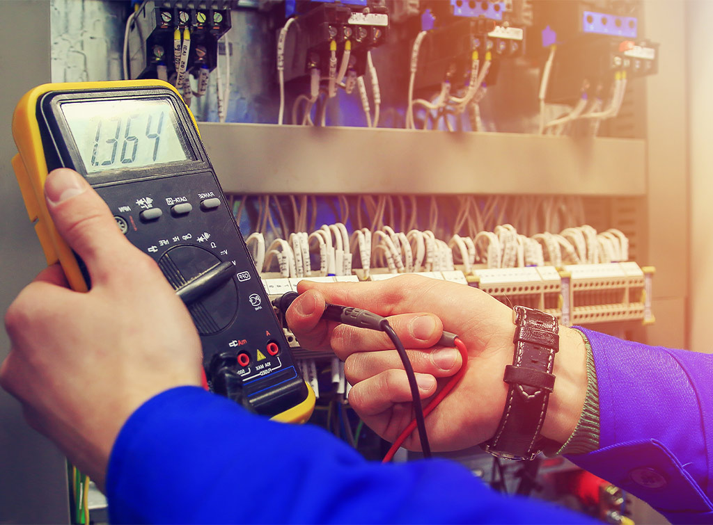 Electrician conducing safety check