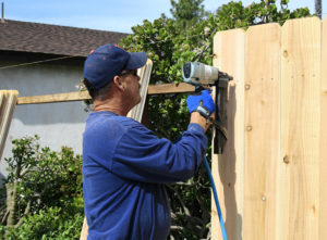 Fence expert repairing fence