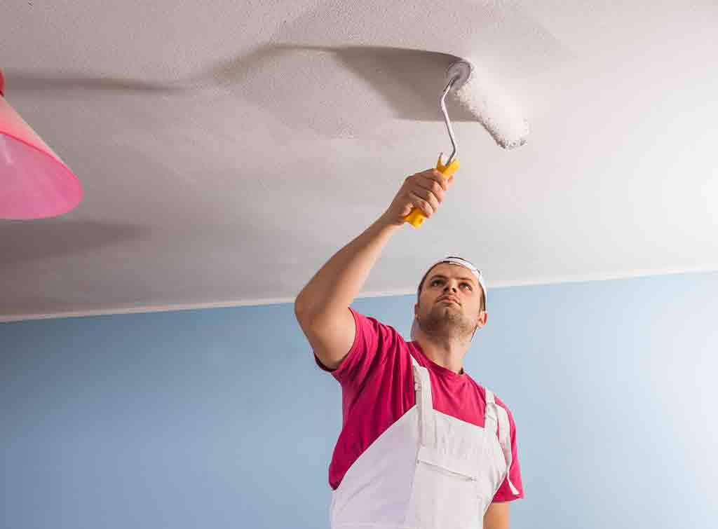 Paint a ceiling with a roller