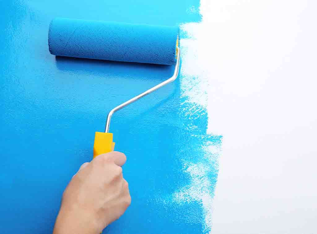Painting a wall by hand